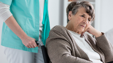 nurse at nursing home with abused elderly woman