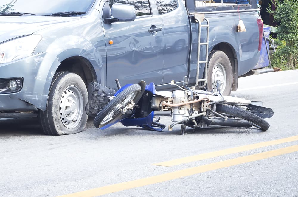 accident between a pickup and a motorcycle on the road